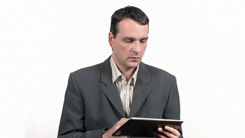 Businessman working on tablet and answering phone call