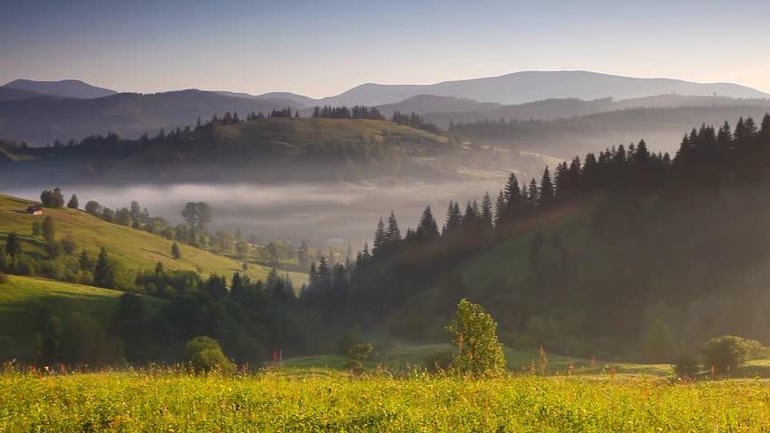 Majestic sunset in the mountains landscape. Carpathian, Ukraine. HD video (High Definition)