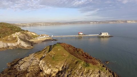 Editorial SWANSEA, UK - November 19, 2017: Mumbles Pier in Swansea. This old Victorian pier is in the process of being renovated starting with the addition of a new lifeboat station.