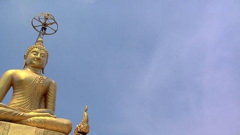 Golden Buddha besides the Big Buddha Statue at Wat Phrathong