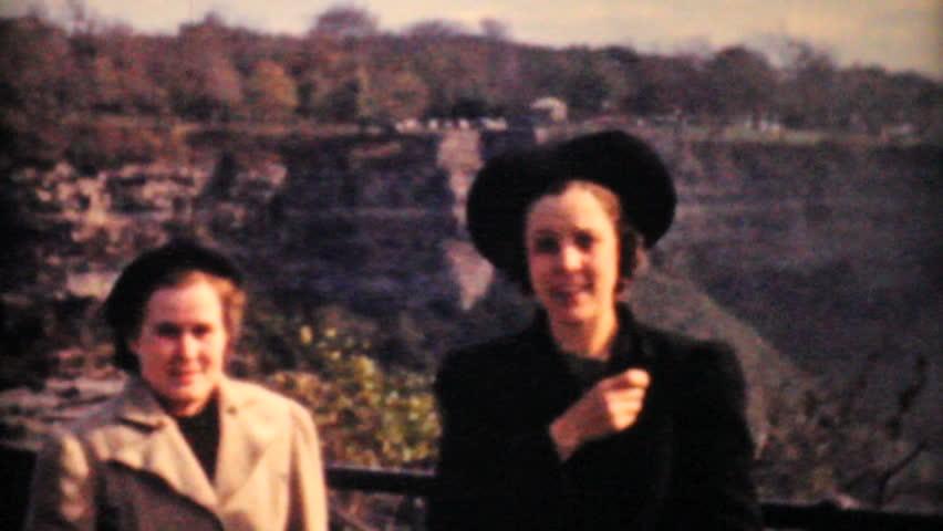NIAGARA FALLS, ONTARIO - JUNE 15, 1958 - 8mm film footage of three woman tourists visiting Niagara Falls on vacation in 1958.