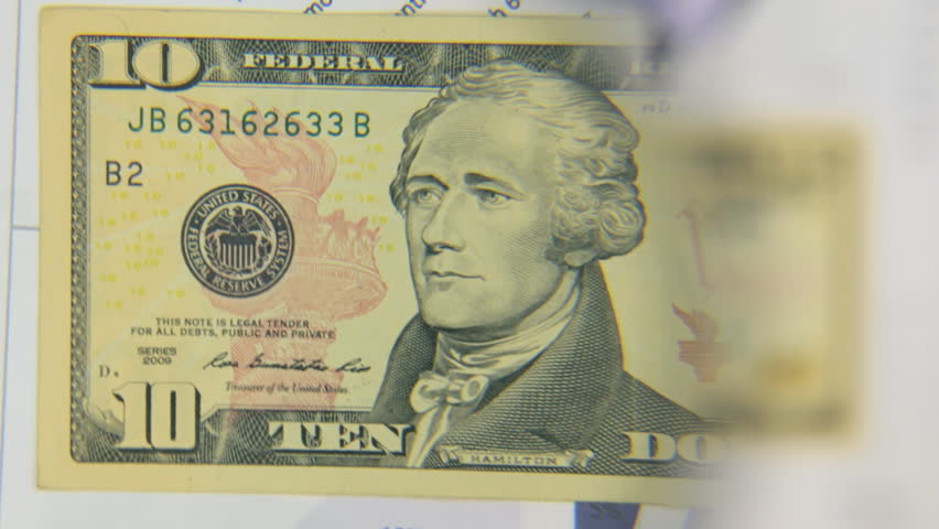 Consider a banknote of ten dollars, an increase with a magnifying glass.   Shutterstock HD Video #33110305