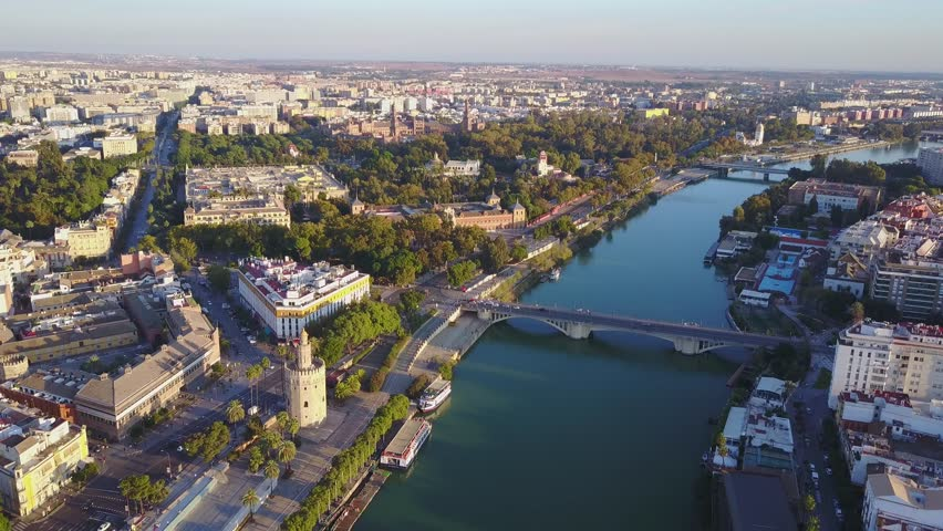 Aerial view of Torre del Ore and river Guadalquivir, Seville, Andalusia, Spain | Shutterstock HD Video #33110425