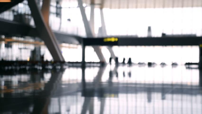 Defocused airport baackground. Silhouette people walking at the airport. | Shutterstock HD Video #33111667