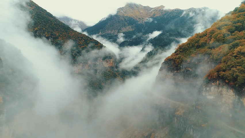 Flying Inside A Canyon In Clouds And Fog.Aerial pass inside a deep gorge/canyon of a national park in Greece during autumn/winter while fog slowly kicks in. | Shutterstock HD Video #33151885