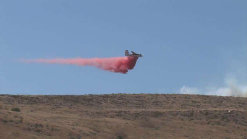Air Tanker Drops Fire Retardant Over Wild Fire
