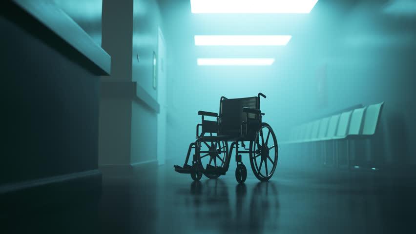 03004 Standard manual wheelchair in empty, foggy hospital corridor. Zoom in camera.   Shutterstock HD Video #33252280