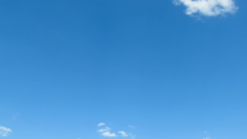 Clouds are moving in the blue sky. TimeLapse. Beautiful White fluffy clouds over blue sky soar in Time lapse. #33252715