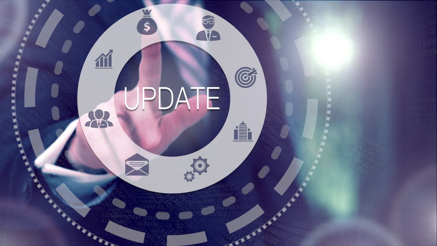 Businessman pressing a Business Update concept button on a clear projection screen | Shutterstock HD Video #33266425