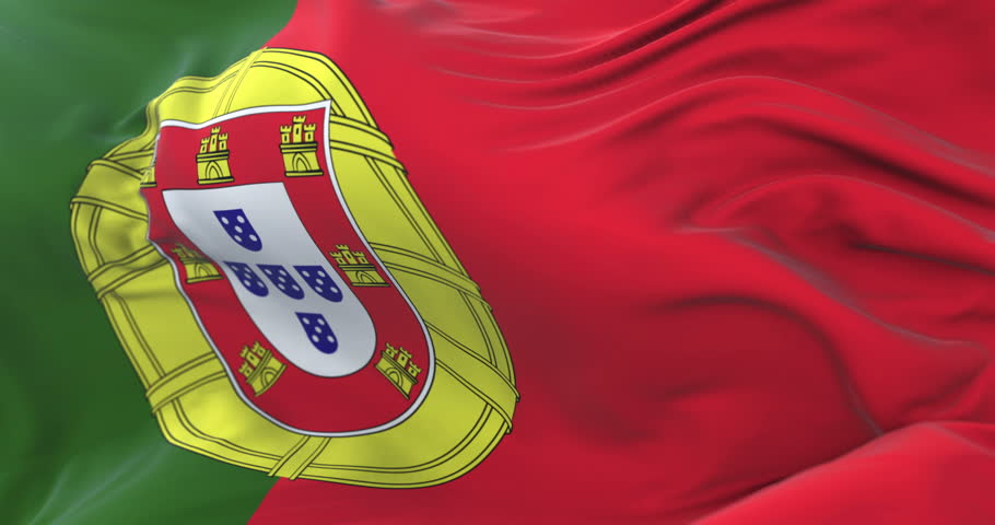 Portugal flag waving at wind in slow with blue sky, loop
