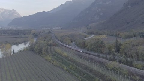 Aerial drone footage view of Train near a river in italy // no video editing