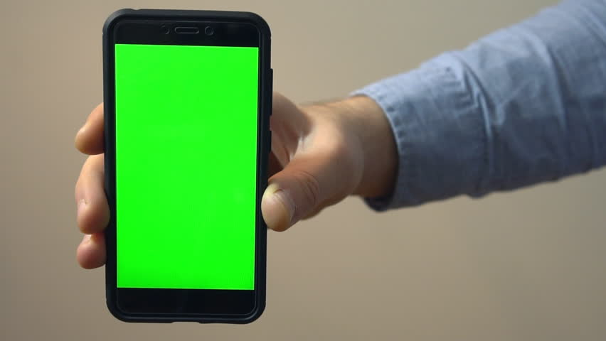 Hand holding mobile phone with green screen. Chroma key. | Shutterstock HD Video #33345715