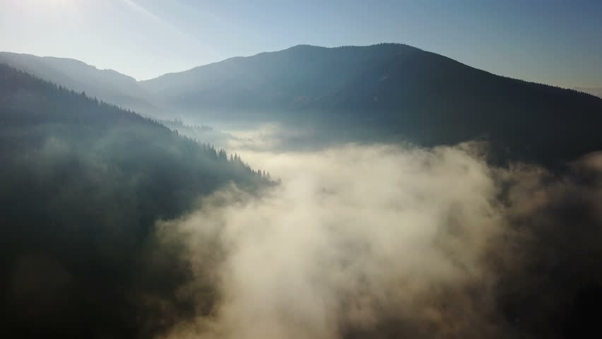 Aerial view of the mountains with a morning fog | Shutterstock HD Video #33383695