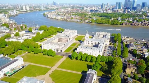 Aerial bird's eye view video taken by drone of Greenwich park with views to Canary Wharf, Isle of Dogs, London, United Kingdom
