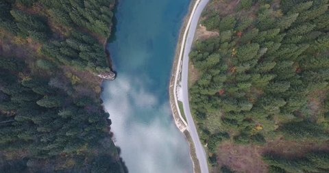 Aerial view of a small lake in Uzungol in Trabzon Province with reflection.