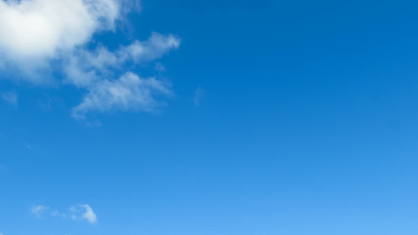 Clouds are moving in the blue sky. TimeLapse. Beautiful White fluffy clouds over blue sky soar in Time lapse. #33410755