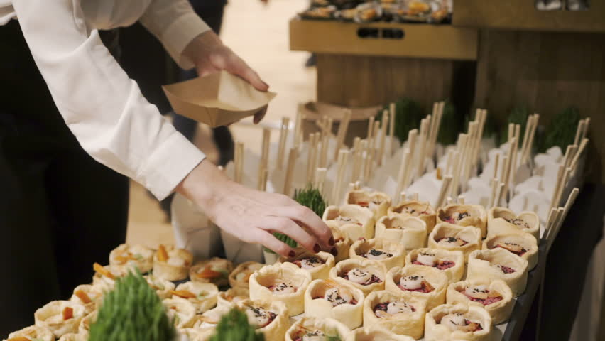People choosing food during buffet catering party, close up view