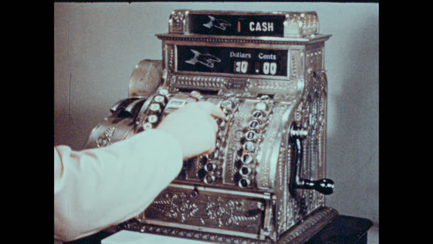 1940s: UNITED STATES: Cash register drawer opens. Shoes and handbags for sale in store. Hands deposit money at bank. Arrow factory sign