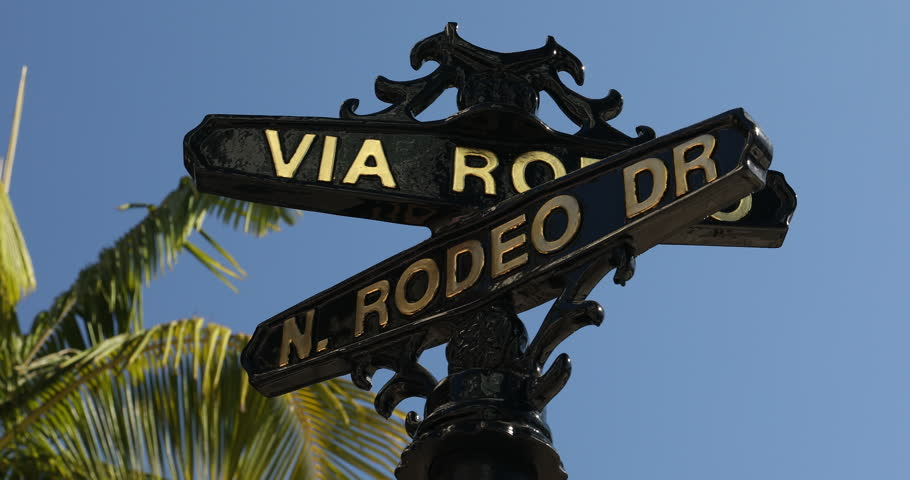 Rodeo Drive road marker in the Beverly Hills shopping district of Los Angeles California USA | Shutterstock HD Video #33499615
