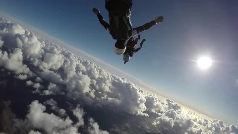 Man Jump And Skydive Together