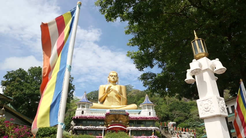 Golden Buddha figure on the island of Sri Lanka