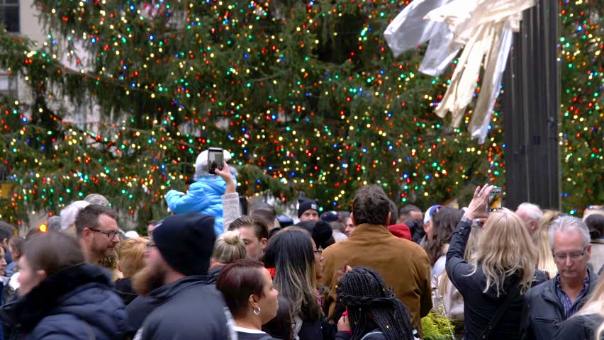 NEW YORK - DECEMBER 3: Close Up Detail Video of The Christmas Tree in Rockefeller Center With Large Groups Of Tourists New York City on December 3, 2017 in New York City.