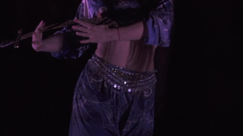 Sexy, young woman belly dancer arabian in exotic dress dancing exotic dance. | Shutterstock HD Video #33556645