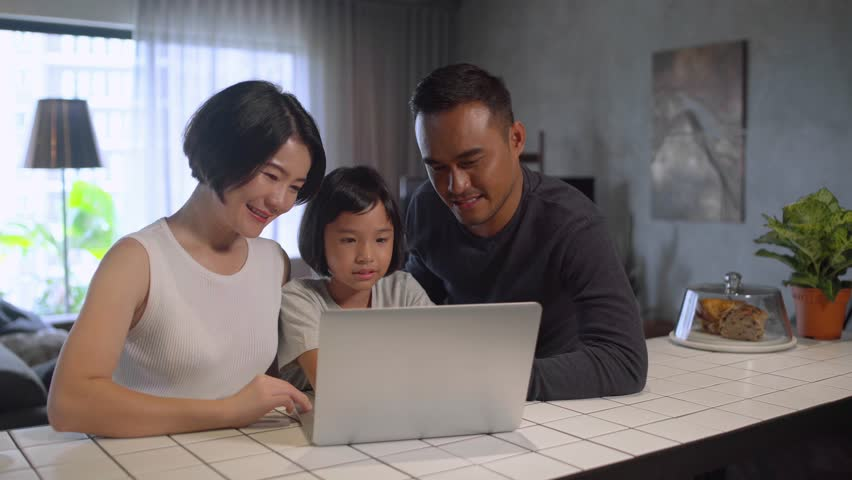 Asian family using the computer.