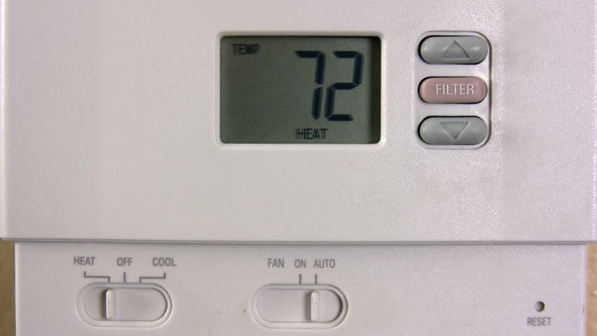 stock video of setting thermostat temperature 335905 shutterstock. Black Bedroom Furniture Sets. Home Design Ideas