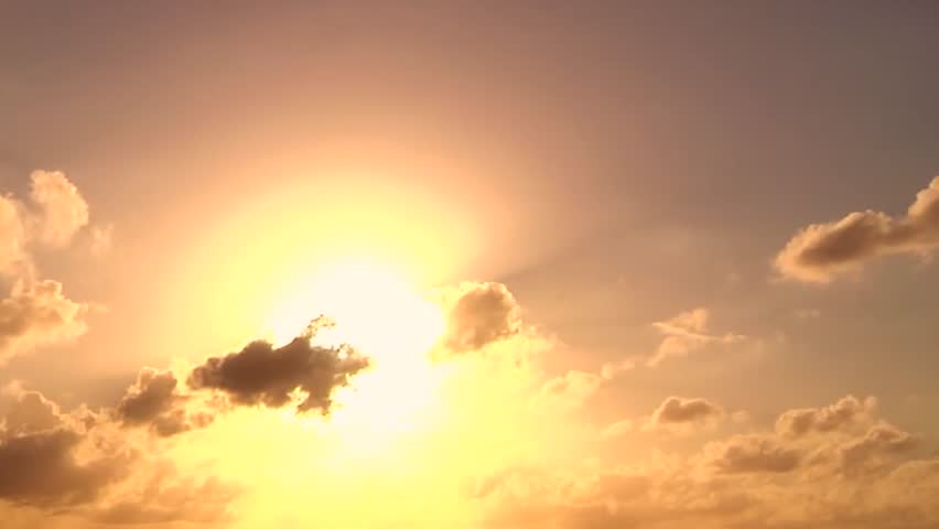 Beautiful sunset clouds over ocean. Time Lapse. Sunset time lapse in impressive fire and smoke colours. Close up focusing on sky close to the setting sun only. Sun through clouds at sunset, Full HD.