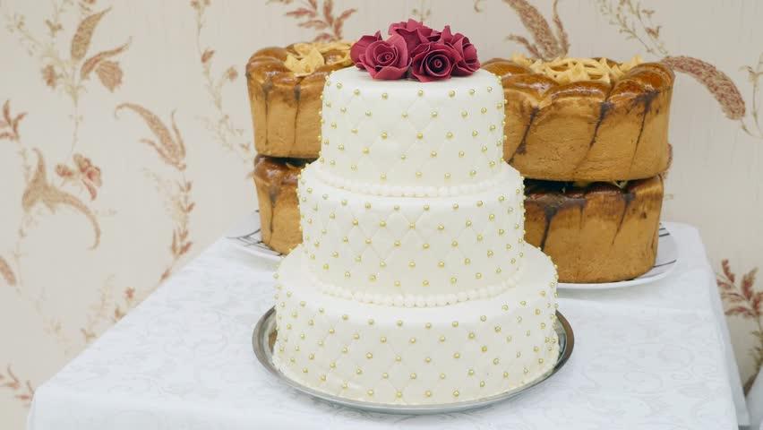 Stock video of kigali rwanda january 2015 inside a 9326558 4k0005close up white wedding cake junglespirit Choice Image