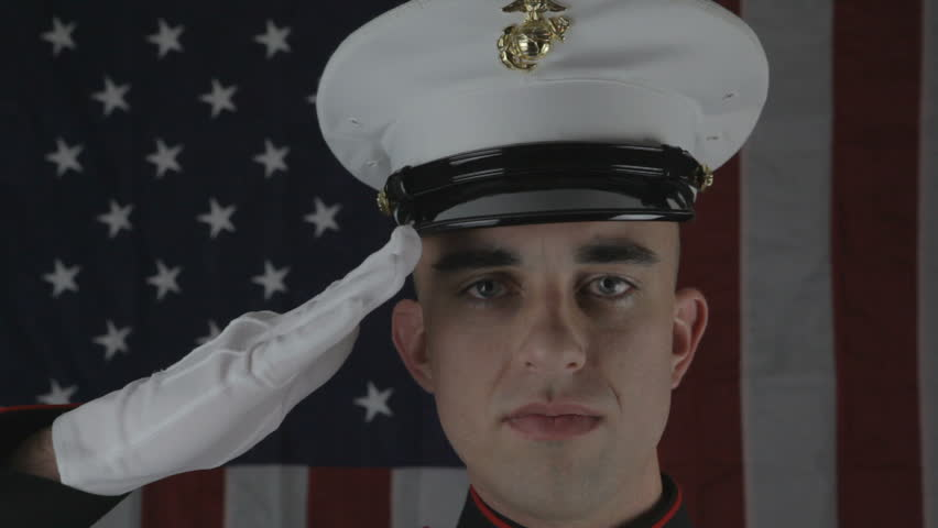 Marine in dress blues salutes