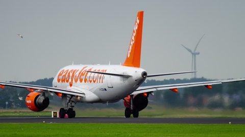 AMSTERDAM, THE NETHERLANDS - JULY 25, 2017: EasyJet Airbus 320 G-EZOB take-off at Polderbaan 36L, Shiphol Airport, Amsterdam, Holland