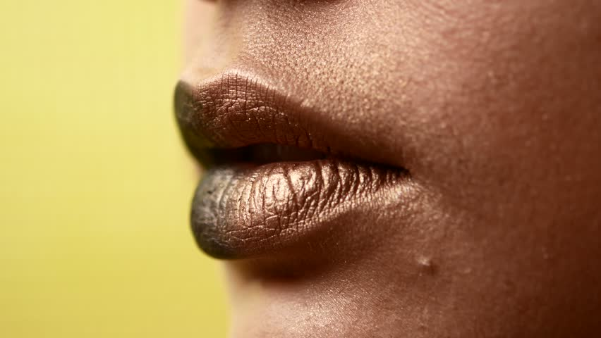 Beautiful and sexy female lips with expensive makeup. Close-up of painted female lips