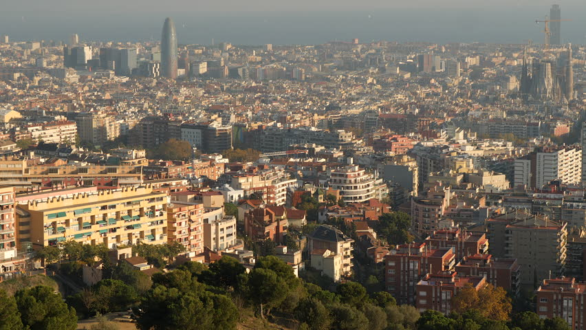 Barcelona cityscape, tilt from mountain and houses to ocean.