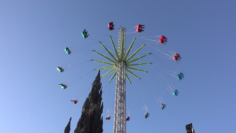 Funfair attraction beside the Scott Monument in Princes Street, Edinburgh.