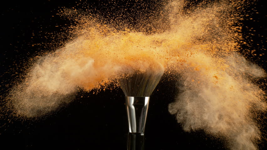 makeup falling off a makeup brush in slow motion