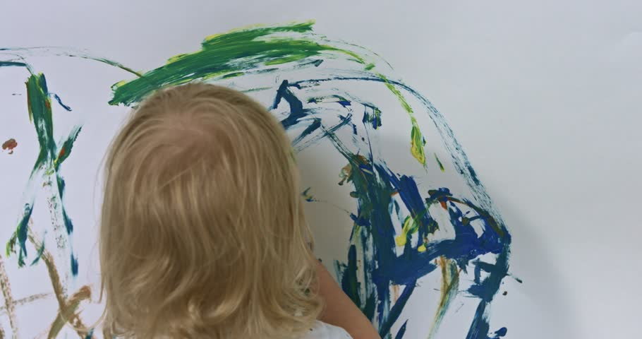 Happy baby girl playing with paints. | Shutterstock HD Video #33767965