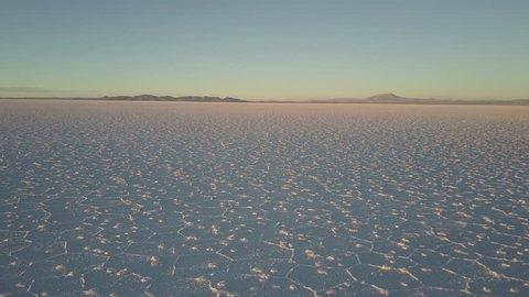 Camera flies slowly forward over Salar de Uyuni salt flat