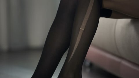 Lady in hurry going to work and accidentally tearing pantyhose, bad start of day