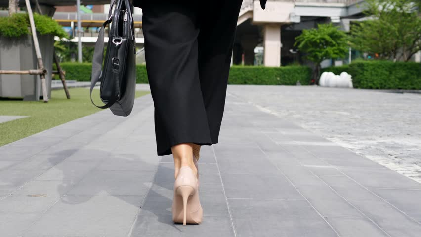 Business Woman Legs In High-Heeled Shoes Walking With Briefcase. Closeup. Slow Motion. 4K.