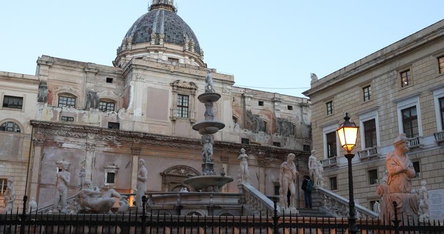 Palermo, Sicily, Italy. Dec 08 2017: Pretoria Fountain of Palermo, fountain of white marble with marble statues of people and animals. Ita: Fontana Pretoria di Palermo, chiamata Fontana della Vergogna