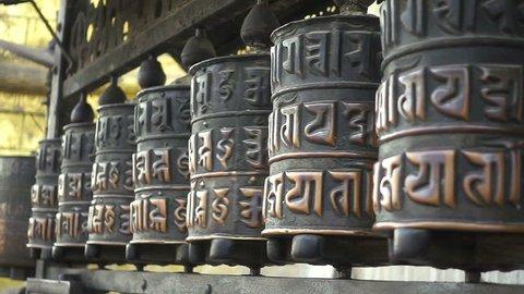 Buddhist prayer wheels. Swayambhunath Stupa, Kathmandu, Nepal