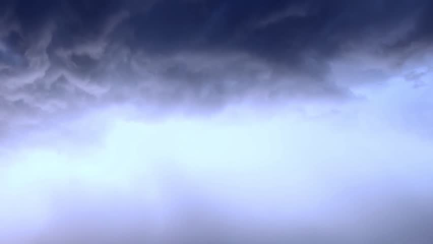 Amazing, unique stormy weather time lapse featuring sandstorm, lightning strike, swirling, fast-moving clouds, strong winds, sweeping rain shafts dumping monsoon rains on mountainous landscape. FHD.