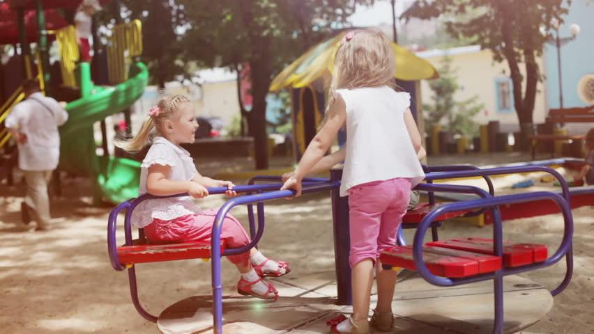 Three happy girls on the playground