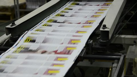 print plant factory, magazine line collecting after passing the press rollers into printing units and folder