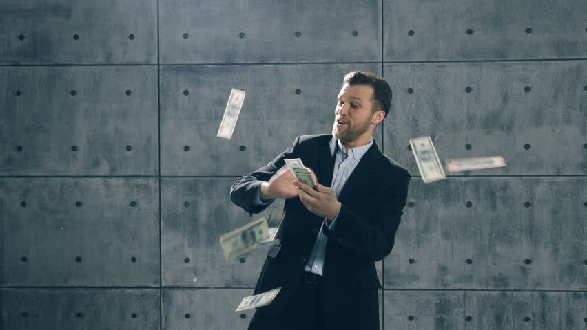 Man in formal suit dancing and throwing money. Slow motion | Shutterstock HD Video #33872305