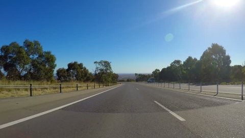 Vehicle POV, driving along freeway with scenic views of Willunga in McLaren Vale, South Australia.