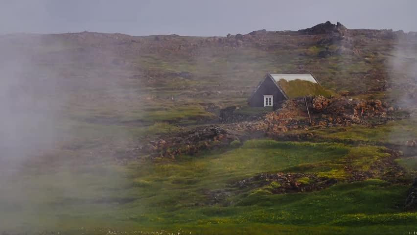Hobbit home, house, hut, cabine Steam Volcanic landscape Geothermal Iceland. Geyser . Steam Volcanic landscape. Martian terrain, acid fumes in backlight, volcanic rocks. Geothermal area, Iceland. Slow