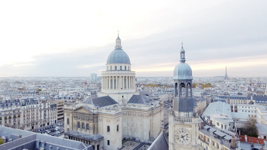 Aerial view of the Pantheon building in the Latin Quarter in Paris and in the background we can see the Eiffel Tower.